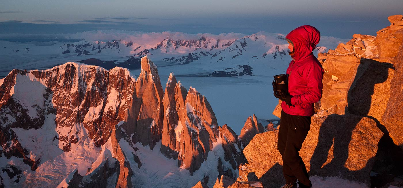 Kate Rutherford looks toward the Cerro Torre massif and the Patagonian Ice Cap from her bivy atop Fi