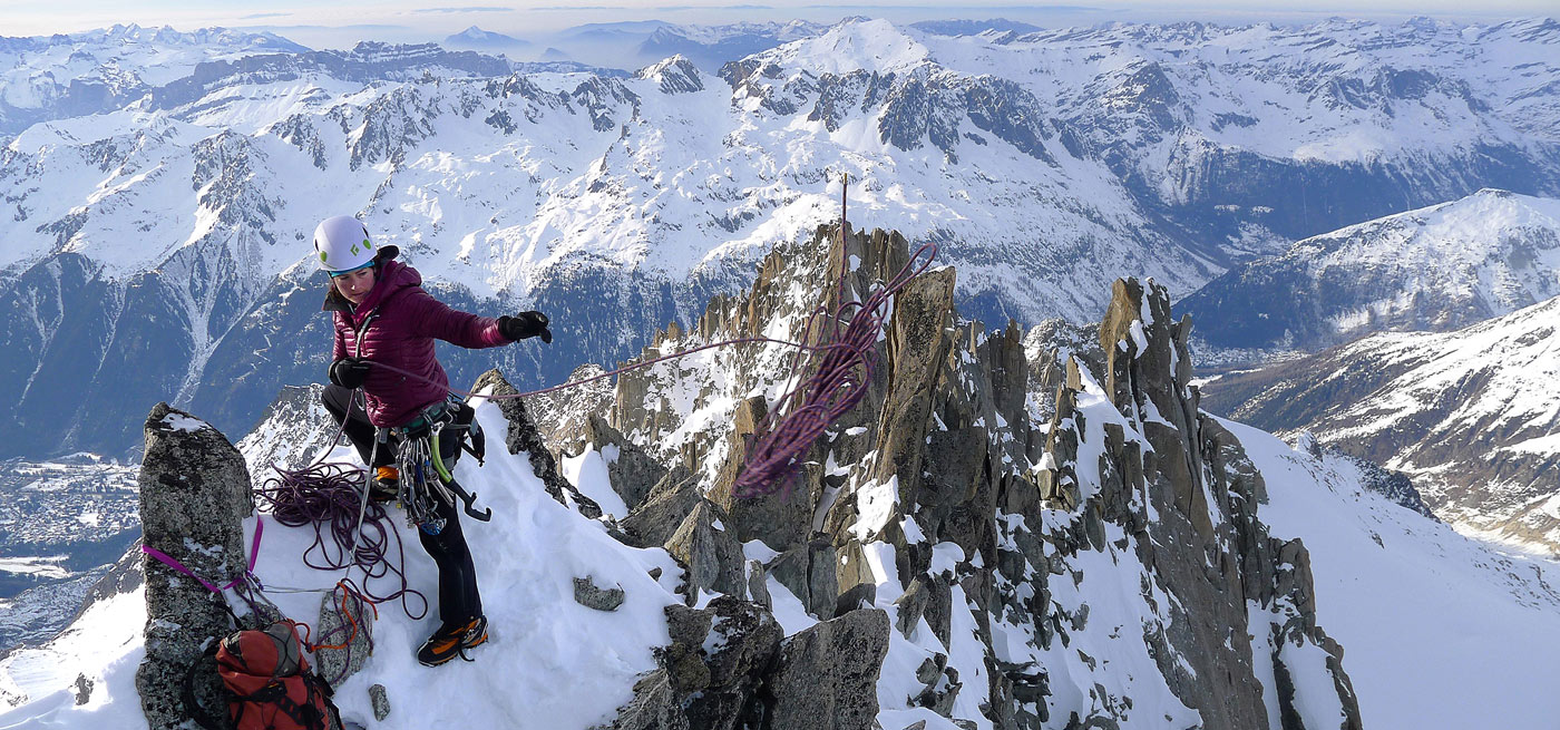 Zoe Hart tops out on Pointe Farrar, on the ridge of the Aguille Verte, after climbing a mixed route