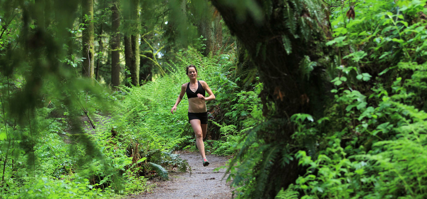 Jenn Shelton enjoys a rare break from the spring rain on the Wildwood Trail in Portland´s Forest Par